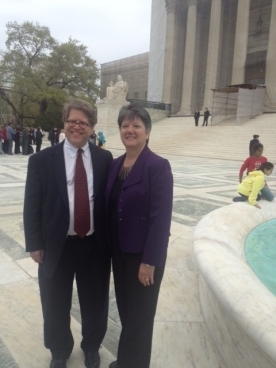 "Mary Steele Williams, Executive Director of Association for Molecular Pathology (AMP), and Dr. Roger Klein, MD, JD, AMP leader, outside the Supreme Court Building, Washington, D.C., during AMP v. Myriad in 2013."" (Provided by AMP)"